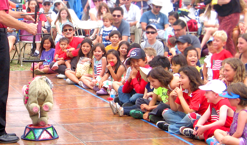 Children watch puppet show